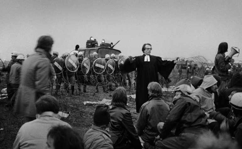 During a violent anti-nuclear power demonstration, Pastor Bode of Bremen tries to keep demonstrators