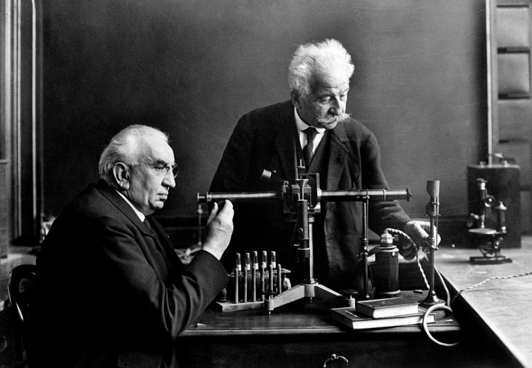 Early film makers, Auguste (1862-1954) and Louis (1864-1948) Lumiere in their laboratory.