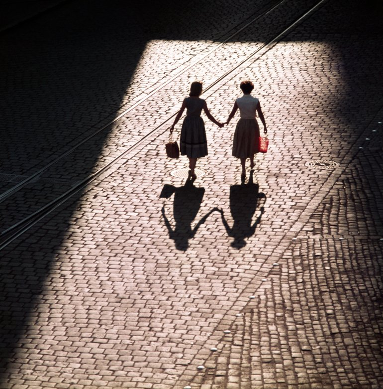 Bavaria, Regensburg, Germany: Two woman walking hand in hand. 01.07.1955 MR