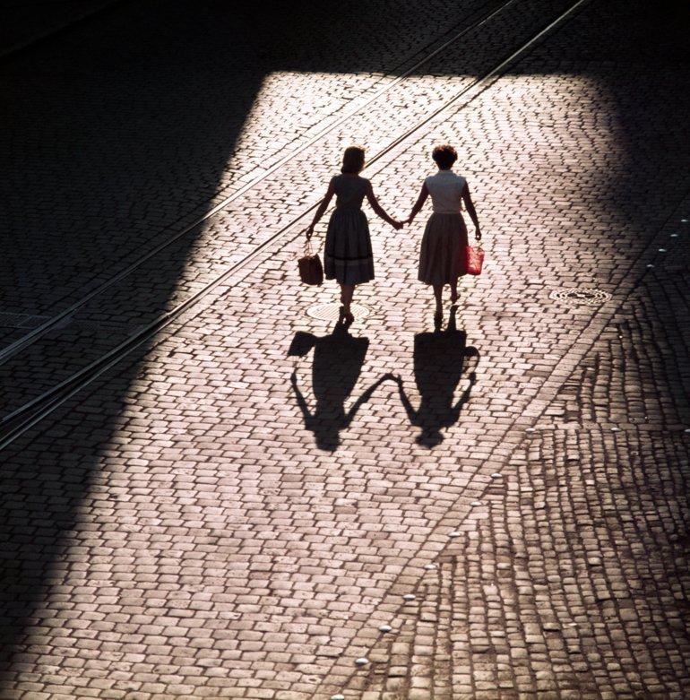 Bavaria, Regensburg, Germany: Two woman walking hand in hand. 01.07.1955 MR