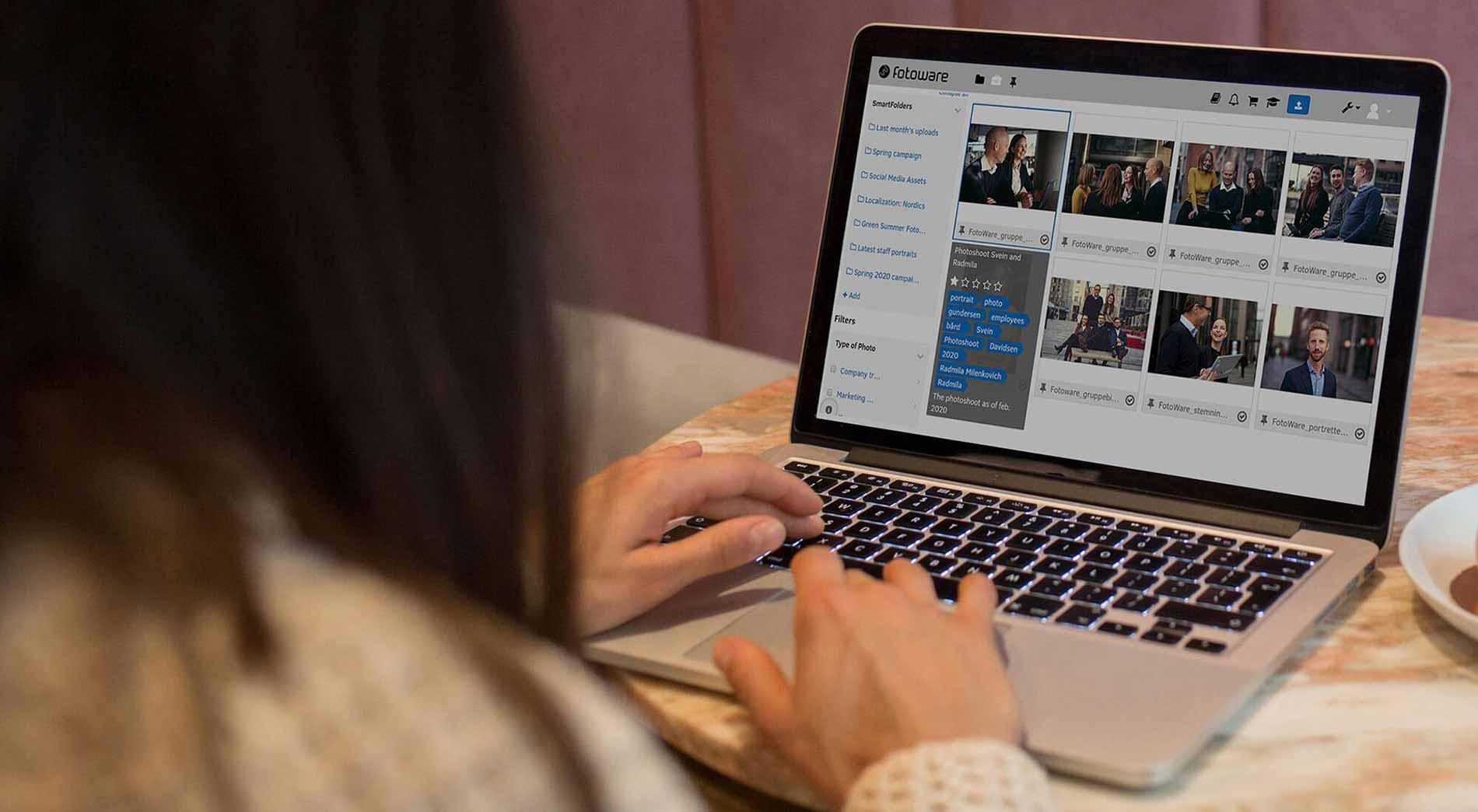 Women using FotoWare DAM system on her laptop
